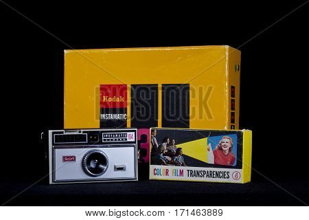 UMEA, SWEDEN ON OCTOBER 28. View of a camera Instamatic 104 from the 1960s on October 28, 2013 in Umea, Sweden. Black background and box and cover. Illustrative Editorial.
