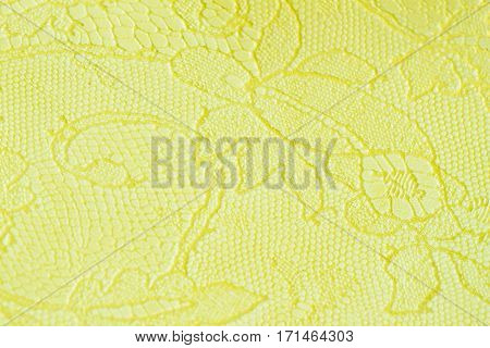 Genuine leather with an abstract ornament, tender light green color. Closeup on a leather texture. For modern pattern, wallpaper or banner design. With place for your text