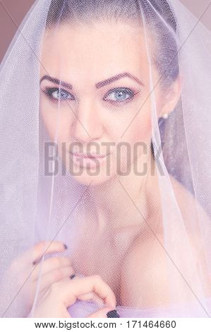 Portrait Of A Young Beautiful Woman In Lilac Veil