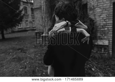 Stylish Couple Having Fun And Hugging In Autumn Park. Hands Closeup. Man And Woman . Joyful Moments