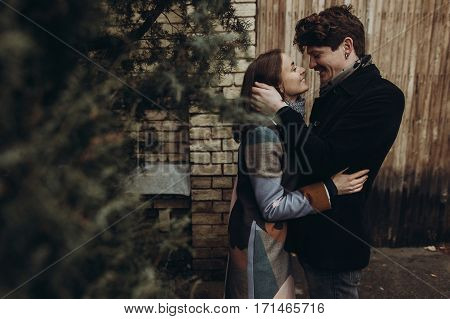 Romantic Stylish Couple Hugging Gently In Autumn Park. Man And Woman Embracing, Showing True Happine