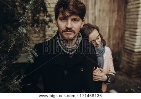 Romantic Stylish Man And Woman Embracing, Couple Hugging Gently In Autumn Park. Showing True Feeling
