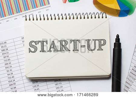 Notebook With Toolls And Notes About Start Up