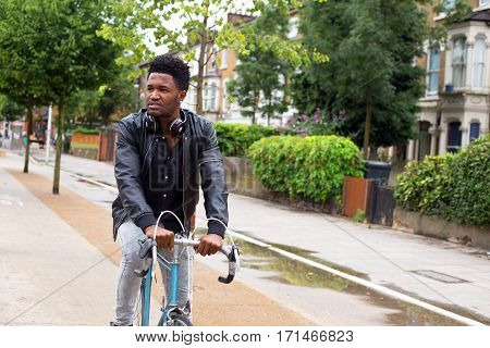 a young man cycling to work in the morning