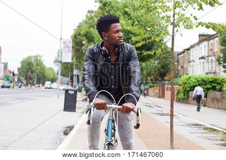 a young man cycling to work on his bike