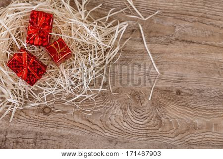 Gift boxes on rustic wood background. Design for celebration and presents. Valentines day gifts concept. Wooden grunge board.