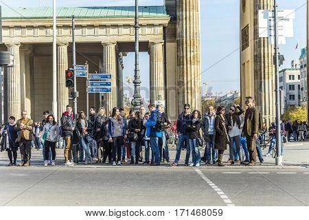 People Visit The Brandenburg Gate (brandenburger Tor) In Berli
