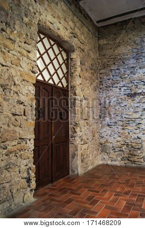 Wooden door in a stone wall. Former Russian winery Abrau Durso.