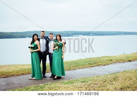 Portrait of a beautiful young drivers and bridesmaids. Wedding.