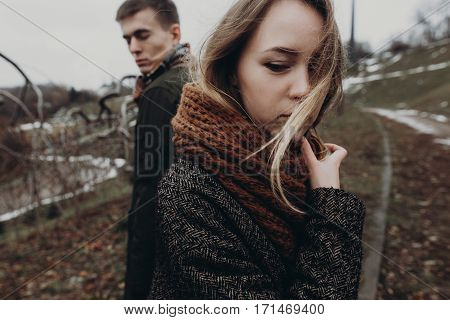 Stylish Hipster Couple Posing On Background Of Park. Sensual Atmospheric Moment With Space For Text.