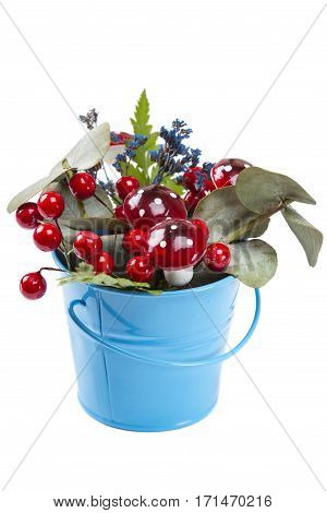 Flowerpot decoration with natural green plant and flowers and artificial mushrooms isolated on white