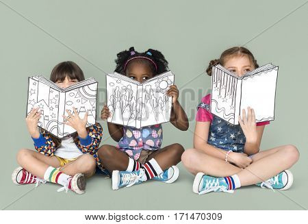 Little Children Reading Sitting Down