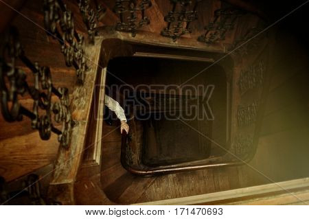 stylish hipster man hand walking up the wooden old stairs in building