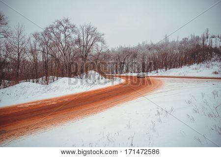 View on winter road that is red because of ore
