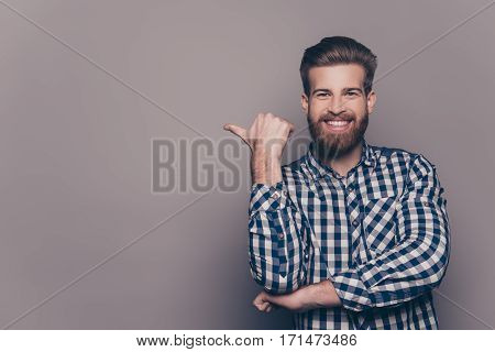Cheerful Toothy Bearded Stylish Man Pointing With Finger
