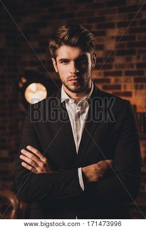 Confident Well-dressed Handsome Young Businessman With Crossed Hands