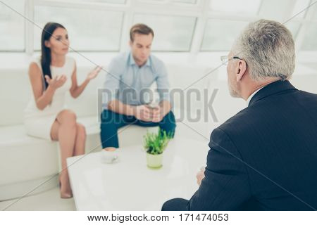 Portrait Of Young Family With Problems At A Reception Of Psychologist