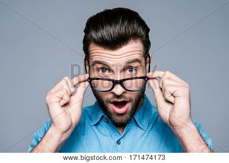 Wow! Surprised Young Man With Opened Mouth Touching Glasses