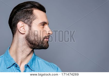 Side View Of Young Stylish Man Isolated On Gray Background
