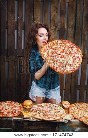 Woman with great pizza. Fat and weight loss problem
