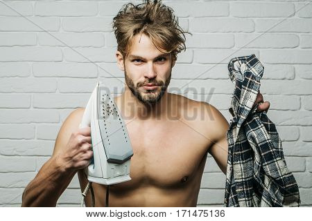 Young Naked Man With Iron