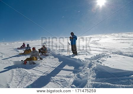 LES DEUX ALPES, FRANCE - FEBRUARY 11, 2015: Skiers and snowboarder on a free ride adventure. Les 2 Alpes is one of the best ski resorts of the Alpes and it has lots of opportunities for free ride.