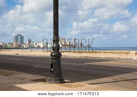 Havana Cuba - January 222017: Havana Malecon. The Malecon (officially Avenida de Maceo) is a broad esplanade roadway and seawall which stretches for 8 km (5 miles) along the coast in Havana