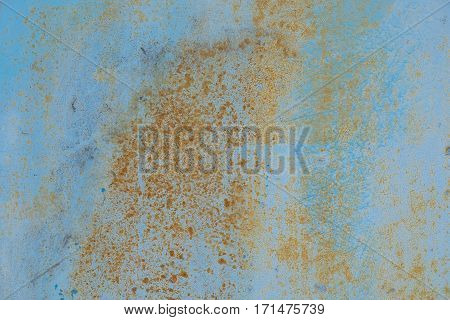 Cracked painted old metal texture. Blue color. Rusted surface.