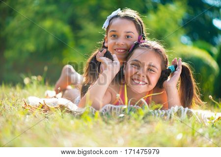 Two Happy Sisters Having Fun In The Park