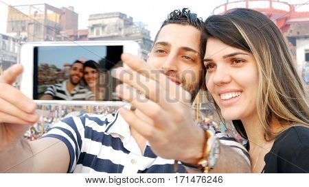 Couple taking a selfie in Varanasi, India