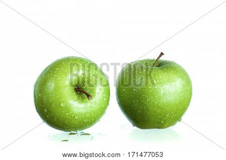Two green apples studio isolated on white background