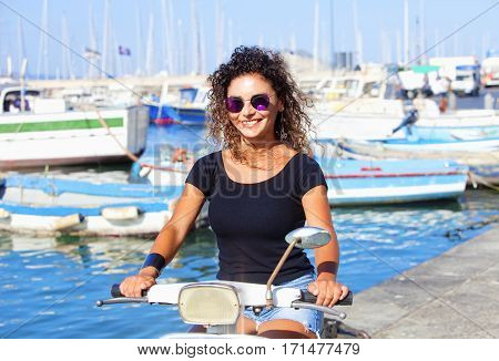 Young Italian Woman, Curly Hair on Scooter Smiling
