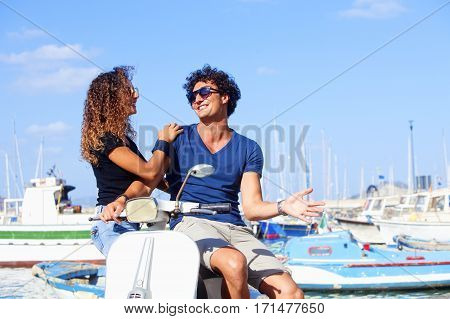 Young Italian Couple on Scooter Having Fun
