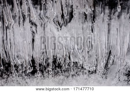 Ice texture. Ice section with bubbles, oxygen in frozen water.