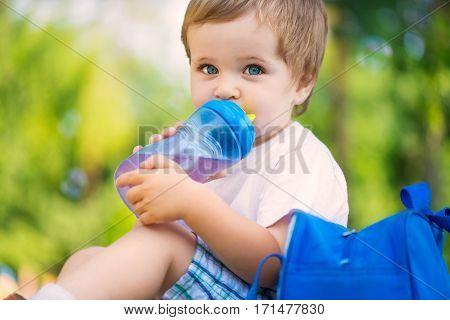 Cute Little Boy Drinking Water