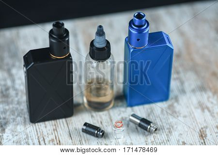 Electronic cigarette mod on the table. Drip Tips. ENDS.