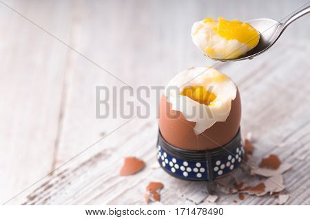 Soft-boiled egg on the white wooden table horizontal