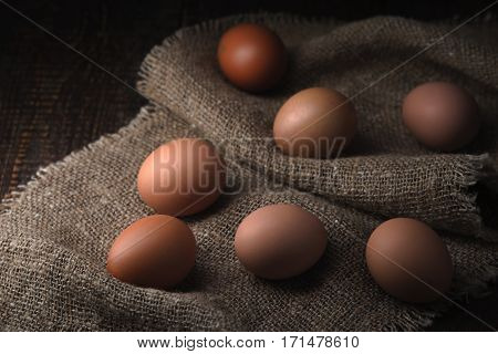 Chicken eggs on the canvas horizontal rustic, table, background