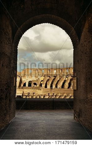 Archway in Colosseum, the world known landmark and the symbol of Rome, Italy.
