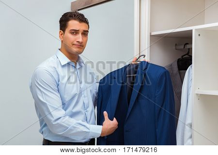 Businessman dressing up for work