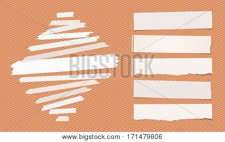 Sticky, adhesive masking tape, ripped note paper strips stuck on squared orange background.