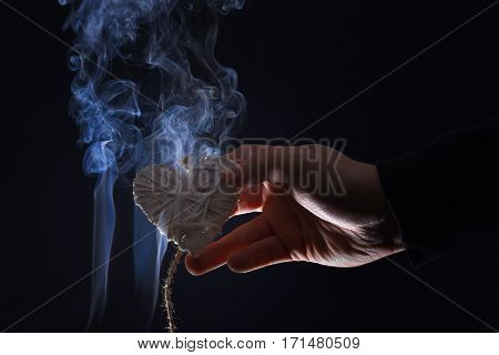 Male Hand With Decorative Valentines Day Heart In Smoke