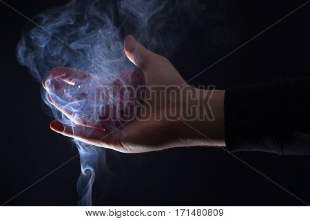 Male Hand With Decorative Valentines Day Red Heart In Smoke
