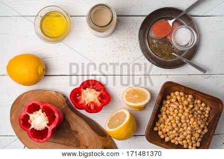 Ingredients for hummus preparation ob the white wooden table top view