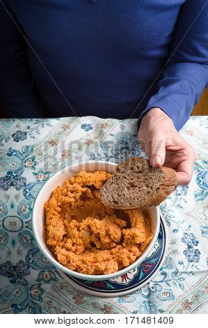 Eating hummus on the patterns background vertical