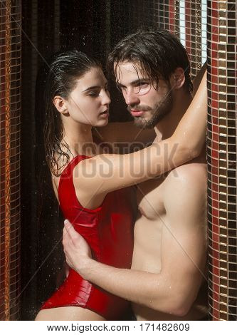 Muscular Man And Sexy Woman In Bath Under Water