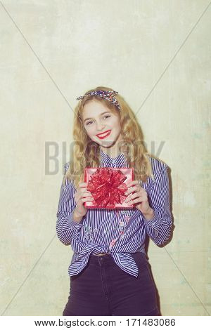 Cheerful Pretty Girl With Red Gift Box