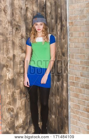 Pretty Girl In Blue And Green Dress And Grey Hat