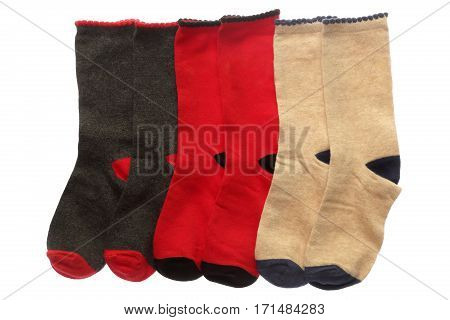 Socks isolated on white background. Color socks close up. Red black white socks.