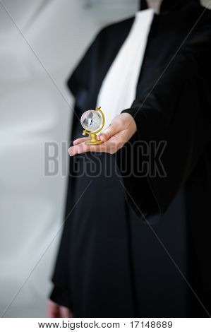 This photograph represents a barrister in wig holding a glass globe in her hand. Great file for your legal brochure global business flyer or site. poster